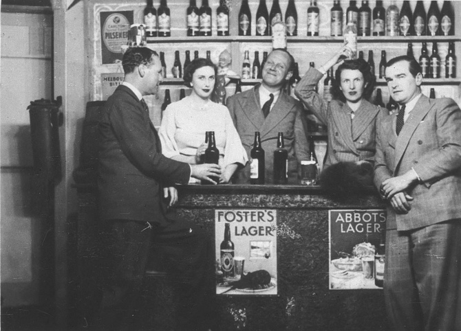 Group around a bar, c. 1930s, by Sam Hood.jpg